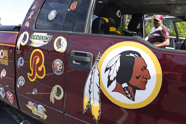 Rodney Johnson of Chesapeake, Va., stands with his truck outside FedEx Field in Landover, Md., Monday, July 13, 2020. The Washington NFL franchise announced Monday that it will drop the