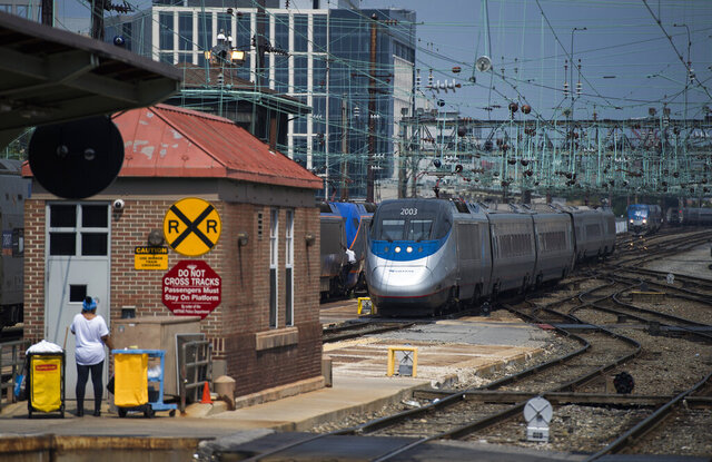 FILE - In this Sept. 3, 2015, file photo, an Amtrak train arrives to Union Station in Washington. Amtrak trains and along with regional partner trains across the U.S. plan to give two blasts of their horns Thursday afternoon, April 16, 2020, in a salute to transportation workers, as well as health care workers, first-responders, child care workers, grocery store employees and other workers providing essential services during the coronavirus pandemic. (AP Photo/Molly Riley, File)