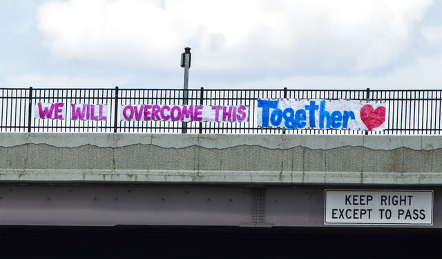 A sign on the 600 North overpass of northbound on I-15 says