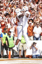 Texas wide receiver Lil'Jordan Humphrey, left, celebrates after scoring a touchdown on a 15-yard reception with teammate John Burt (1) against Oklahoma during the second half of an NCAA college football game at the Cotton Bowl, Saturday, Oct. 6, 2018, in Dallas. (AP Photo/Cooper Neill)