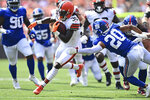 Cleveland Browns running back D'Ernest Johnson (30) rushes against New York Giants cornerback Julian Love (20) during the first half of an NFL football game, Sunday, Aug. 22, 2021, in Cleveland. (AP Photo/David Dermer)