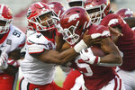 Georgia's Nolan Smith (4) tackles Arkansas running back Rakeem Boyd (5) during the second half of an NCAA college football game in Fayetteville, Ark., Saturday, Sept. 26, 2020. (AP Photo/Michael Woods)