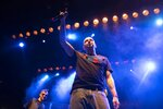 In this photo taken on Monday, Dec. 26, 2018, Russian rapper Oxxxymiron, whose real name is Miron Fyodorov, performs during a concert in support of rapper Husky, whose real name is Dmitry Kuznetsov, in Moscow, Russia. In recent months, Russian artists have experienced a spike in pressure from the authorities, with a string of concert cancellations and arrests that have brought an outcry from critics who see it as the latest expression of censorship against Russian musicians. (AP Photo/Pavel Golovkin)