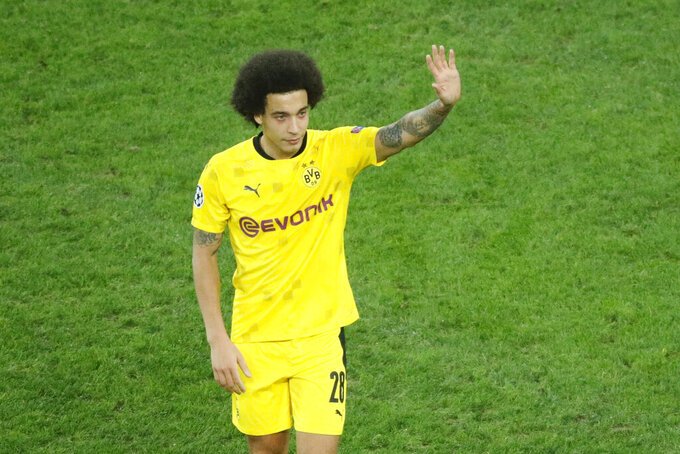 Dortmund's Axel Witsel celebrates as his team won the Champions League group F soccer match between Zenit St.Petersburg and Borussia Dortmund at the Saint Petersburg stadium in St. Petersburg, Russia, Tuesday, Dec. 8, 2020. (AP Photo/Dmitri Lovetsky)