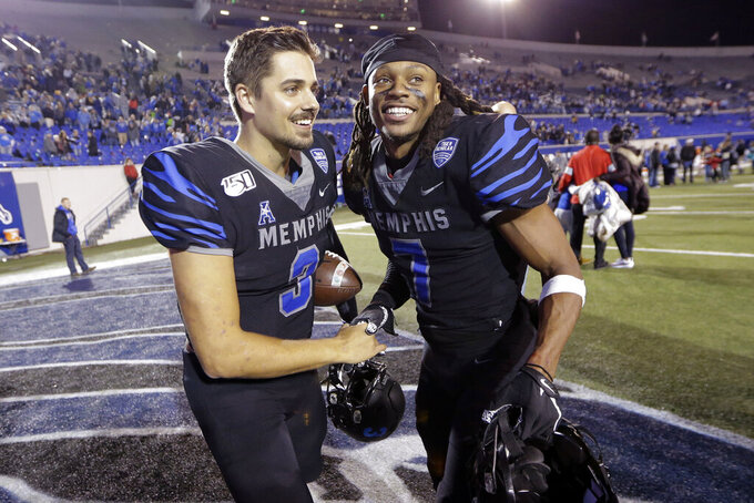 Memphis quarterback Brady White (3) and defensive back Chris Claybrooks (7) celebrate after an NCAA college football game against Cincinnati, Friday, Nov. 29, 2019, in Memphis, Tenn. (AP Photo/Mark Humphrey)