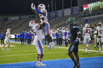 SMU running back Ulysses Bentley IV (26) celebrates a touchdown with offensive lineman Hayden Howerton (75) during the second half an NCAA college football game against Tulane in New Orleans, Friday, Oct. 16, 2020. (AP Photo/Matthew Hinton)