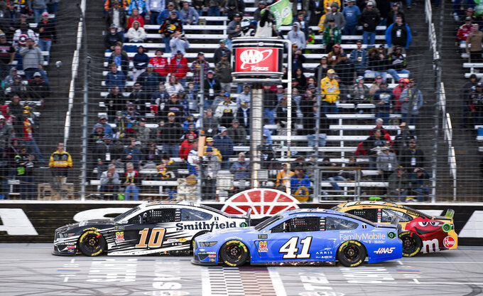 Aric Almirola (10) Daniel Suarez (41) and Kyle Busch (18) battle for position during a NASCAR Cup Series auto race at Texas Motor Speedway, Sunday, Nov. 3, 2019, in Fort Worth, Texas. (AP Photo/Larry Papke)