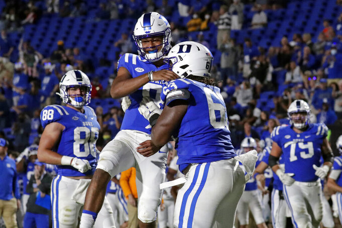 Duke quarterback Jordan Moore (8) celebrates with teammates Jacob Monk (63) and Jake Marwede (88) after scoring a touchdown against North Carolina A&T during the second half of an NCAA college football game in Durham, N.C., Friday, Sept. 10, 2021. (AP Photo/Chris Seward)