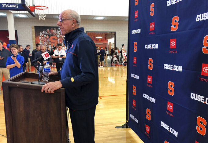 Syracuse coach Jim Boeheim speaks Friday, Oct, 11, 2019, at the team's annual media day in Syracuse, N.Y. The team is ahead of schedule after a summer trip to Italy. They are to open the season Nov. 6, 2019, at home against reigning national champion Virginia. (AP Photo/John Kekis)