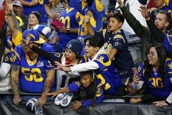 Los Angeles Rams fans cheer after an NFL football game against the Arizona Cardinals, Sunday, Dec. 1, 2019, in Glendale, Ariz. The Rams won 34-7. (AP Photo/Ross D. Franklin)