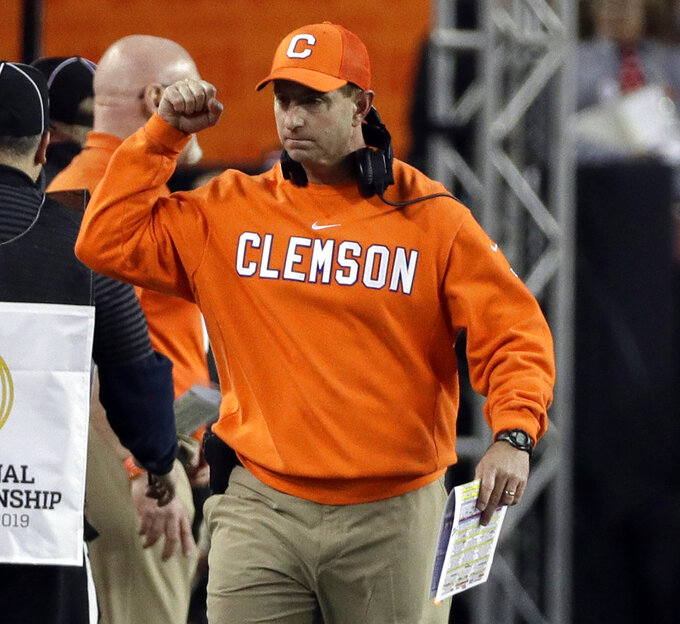 Clemson head coach Dabo Swinney reacts after a touchdown during the first half the NCAA college football playoff championship game against Alabama, Monday, Jan. 7, 2019, in Santa Clara, Calif. (AP Photo/David J. Phillip)