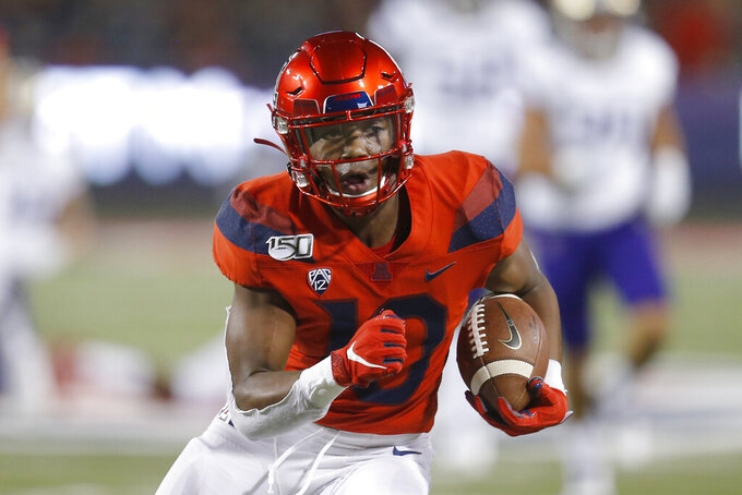 Arizona wide receiver Jamarye Joiner (10) scores a touchdown against Washington during the first half of an NCAA college football game Saturday, Oct. 12, 2019, in Tucson, Ariz. (AP Photo/Rick Scuteri)