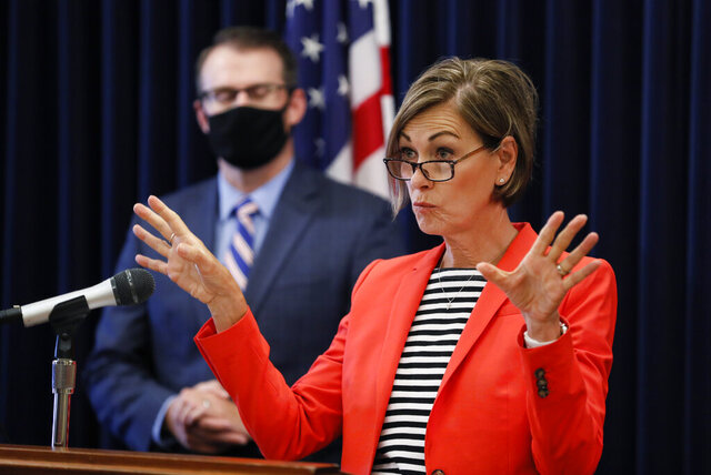 Iowa Gov. Kim Reynolds speaks at a news conference on the state's guidance for returning to school in response to the coronavirus outbreak, Thursday, July 30, 2020, in Des Moines, Iowa. (AP Photo/Charlie Neibergall)