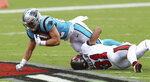 FILE - In this Sept. 20, 2020, file photo, Carolina Panthers running back Christian McCaffrey (22) is tripped by Tampa Bay Buccaneers safety Antoine Winfield Jr. (31) during the first half of an NFL football game in Tampa, Fla. McCaffrey was limited to six games this season, first because of a high ankle sprain and then a shoulder injury. (AP Photo/Mark LoMoglio, File)