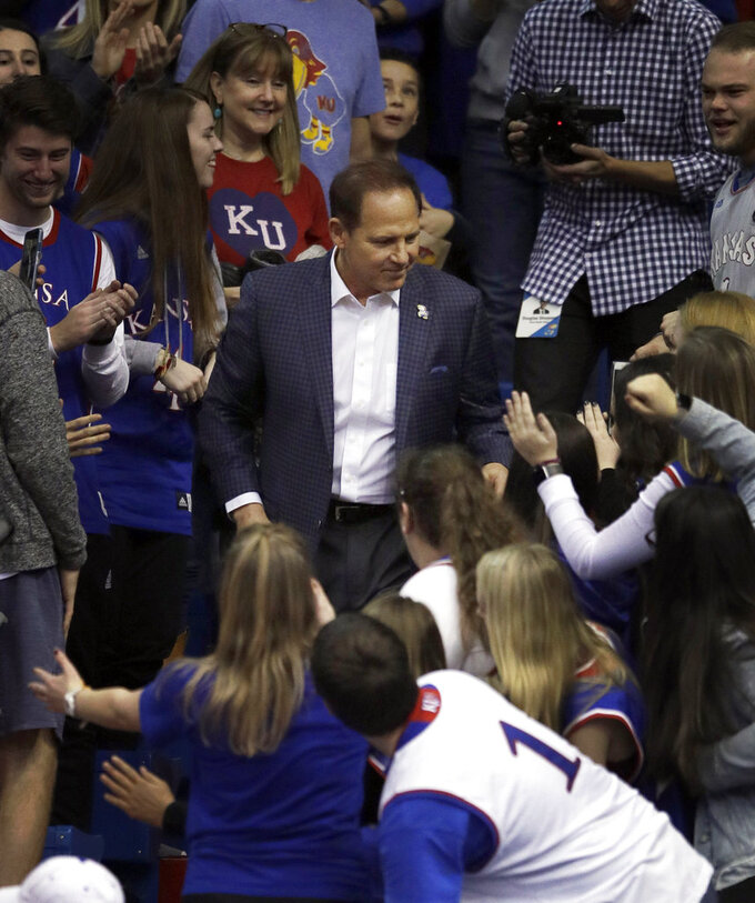 New Kansas football coach Les Miles greets fans during halftime of an NCAA college basketball game against Stanford in Lawrence, Kan., Saturday, Dec. 1, 2018. (AP Photo/Orlin Wagner)