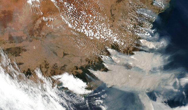 FILE - This satellite image provided by NASA on Saturday, Jan. 4, 2020 shows wildfires in Victoria and New South Wales, Australia. Climate change raised the chances of Australia's extreme fire season by at least 30%, according to a study released Wednesday, March 4, 2020, by climate scientists at the World Weather Attribution group. (NASA via AP)