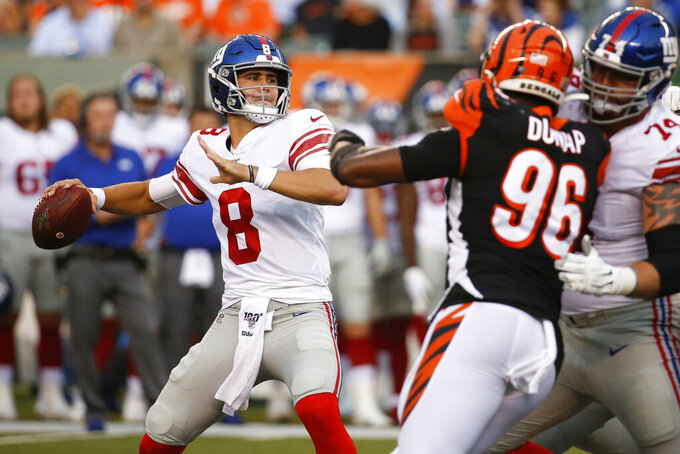 FILE - In this Aug. 22, 2019, file photo, New York Giants quarterback Daniel Jones (8) looks for a receiver during the first half of an NFL preseason football game against the Cincinnati Bengals in Cincinnati. While Jones seemingly is the future of the Giants at quarterback, the sixth pick overall in the draft has a lot to learn before taking over from Eli Manning. (AP Photo/Frank Victores, File)