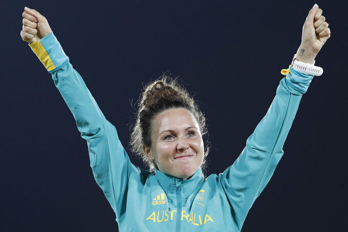 "FILE - In this Aug. 19, 2016, file photo, Chloe Esposito of Australia celebrates winning the gold medal at the awards ceremony of the women's modern pentathlon at the Summer Olympics in Rio de Janeiro, Brazil. Esposito announced in late January that a ""wonderful, unexpected surprise"" had occurred and that the Australian wouldn't be able to defend her modern pentathlon gold medal at the Tokyo Olympics. She was pregnant with her first child. Two months later Esposito and thousands of other Olympic athletes learned that the Tokyo Games would be put off by a year until July 2021 because of the coronavirus pandemic. While for some it meant more time to recover from injuries or extra time to prepare, Esposito realized it might give her a second chance to be in Tokyo next year. (AP Photo/Natacha Pisarenko, File)"