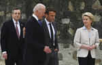 From left, Italian Prime Minister Mario Draghi, US President Joe Biden, President of France, Emmanuel Macron and European Commission Ursula von der Leyen speak after posing for photos for the Leaders official welcome and group photo session, during the G7 Summit, in Carbis Bay, Cornwall, England, Friday, June 11, 2021. (Leon Neal/Pool Photo via AP)