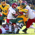 CORRECTS TO UPDATE WILSON IS LOST FOR THE SEASON - FILE - In this Jan. 5, 2019, file photo, North Dakota State running back Seth Wilson is wrapped up by Eastern Washington defensive back Nzuzi Webster (6), defensive back Anfernee Gurley, right, and linebacker Chris Ojoh (58) during the first half of the FCS championship NCAA college football game in Frisco, Texas. Wilson averaged more yards per carry last year than any other regular back and was expected to play a key role until he was lost for the season to knee injury for a team that is already replacing eight players on offense and seven on defenses. Despite all the holes to fill, the defending FCS champs are is ranked No. 1 in a preseason poll of FCS coaches. (AP Photo/Jeffrey McWhorter, File)