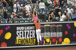 Baltimore Orioles left fielder Austin Hays attempts to catch a two-run home run hit by New York Yankees' Aaron Judge during the second inning of a baseball game Saturday, May 15, 2021, in Baltimore. (AP Photo/Terrance Williams)
