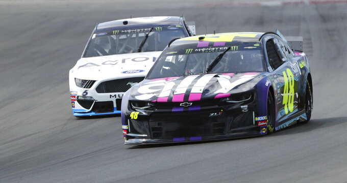 Jimmie Johnson (48) heads into Turn 1 during a practice for the NASCAR Cup Series auto race at Watkins Glen International, Saturday, Aug. 3, 2019, in Watkins Glen, N.Y. (AP Photo/John Munson)