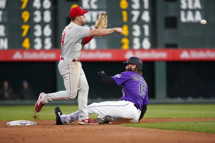 Philadelphia Phillies second baseman Scott Kingery throws to first after forcing out Colorado Rockies' Charlie Blackmon (19) during the third inning of a baseball game Thursday, April 18, 2019, in Denver. David Dahl was safe at first. (AP Photo/Jack Dempsey)