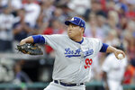 National League starting pitcher Hyun-Jin Ryu, of the Los Angeles Dodgers, throws during the first inning of the MLB baseball All-Star Game against the American League, Tuesday, July 9, 2019, in Cleveland. (AP Photo/Tony Dejak)