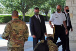 Secretary of the Army Ryan McCarthy, center, into the Killeen Civic and Conference Center Thursday morning, Aug. 6, 2020, ahead of a meeting with local officials in Killeen, Texas. (Hunter King/The Killeen Daily Herald via AP)