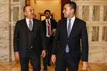 Italian Minister of Foreign Affairs Luigi Di Maio, right, meets Turkish Minister of Foreign Affairs, Mevlut Cavusoglu at the Farnesina foreign ministry headquarters, in Rome, Thursday, Dec. 5, 2019. (Fabio Frustaci/ANSA via AP)