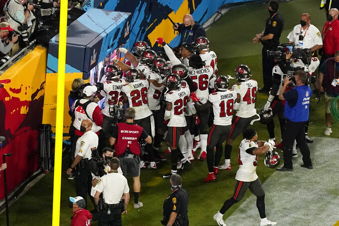 The Tampa Bay Buccaneers defense celebrates an interception during the second half of the NFL Super Bowl 55 football game against the Kansas City Chiefs Sunday, Feb. 7, 2021, in Tampa, Fla. (AP Photo/Chris Carlson)