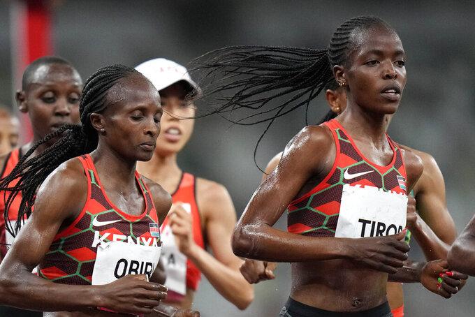 FILE - In this Monday, Aug. 2, 2021 file photo, Kenya's Hellen Obiri, center, and Agnes Tirop, right, compete in the women's 5,000-meters final at the 2020 Summer Olympics in Tokyo. Kenyan runner Agnes Tirop, a two-time world championships bronze medalist, has been found dead at her home in Iten in western Kenya, the country's track federation said Wednesday, Oct. 13, 2021. (AP Photo/Petr David Josek, File)