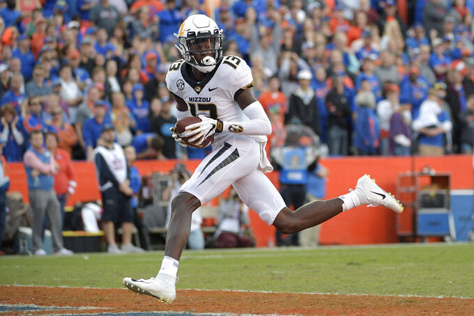 Missouri wide receiver Kam Scott (13) runs into the end zone after catching a pass for a 41-yard touchdown during the second half of an NCAA college football game against Florida, Saturday, Nov. 3, 2018, in Gainesville, Fla. (AP Photo/Phelan M. Ebenhack)
