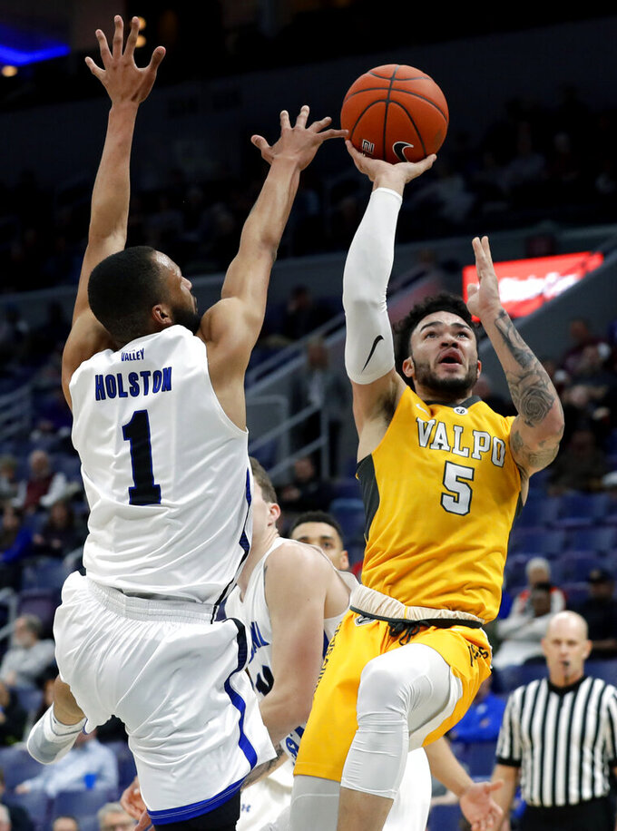 Valparaiso's Markus Golder, right, shoots next to Indiana State's Allante Holston during the first half of an NCAA college basketball game in the first round of the Missouri Valley Conference men's tournament Thursday, March 7, 2019, in St. Louis. (AP Photo/Jeff Roberson)