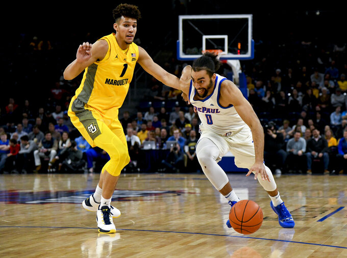 DePaul guard Lyrik Shreiner (0) drives against Marquette forward Brendan Bailey (1) during the first half of an NCAA college basketball game on Tuesday, Feb. 12, 2019. in Chicago, Ill. (AP Photo/Matt Marton)