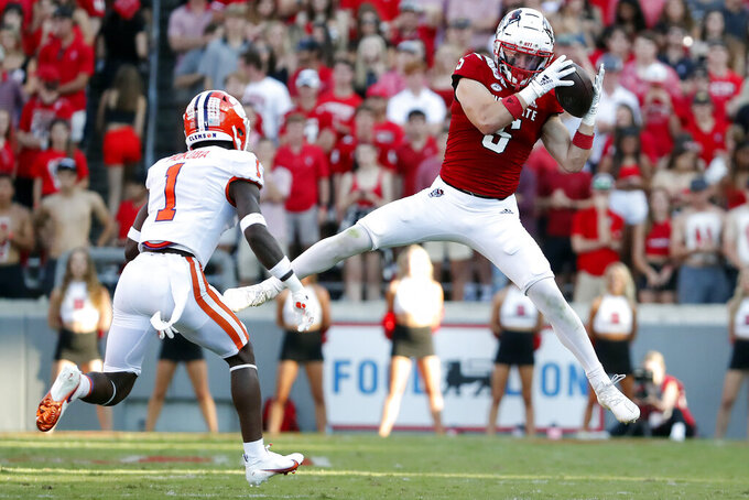 North Carolina State's Thayer Thomas (5) hauls in a pass in front of Clemson's Andrew Mukuba (1) during the second half of an NCAA college football game in Raleigh, N.C., Saturday, Sept. 25, 2021. (AP Photo/Karl B DeBlaker)