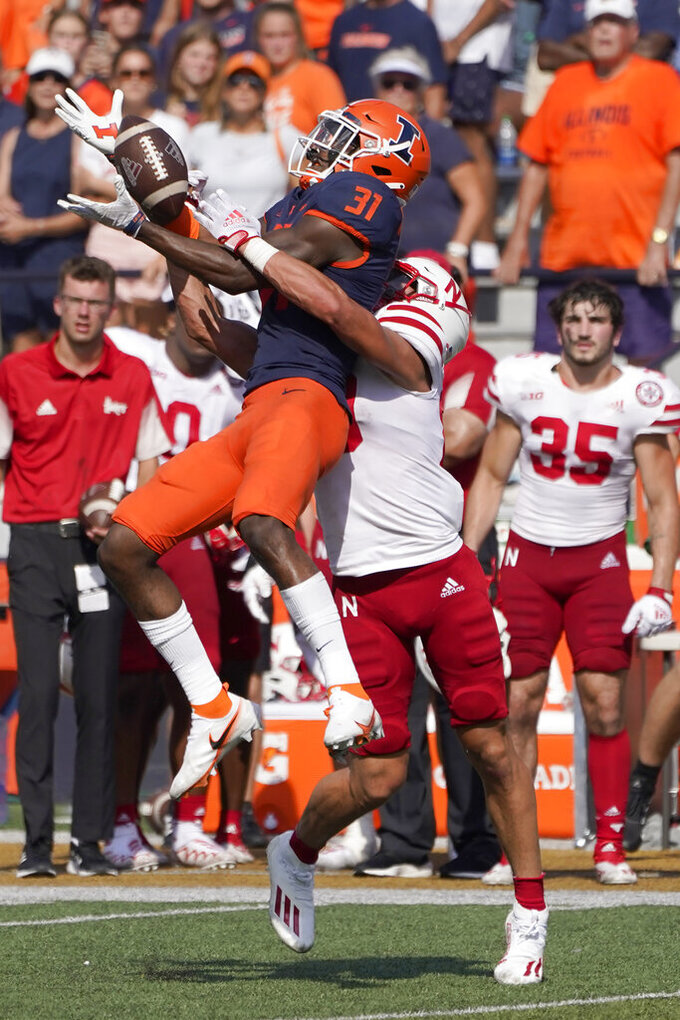 Illinois defensive back Devon Witherspoon steps in front of and breaks up a pass intended for Nebraska wide receiver Oliver Martin late in the second half of an NCAA college football game Saturday, Aug. 28, 202, in Champaign, Ill. Illinois won 30-22. (AP Photo/Charles Rex Arbogast)