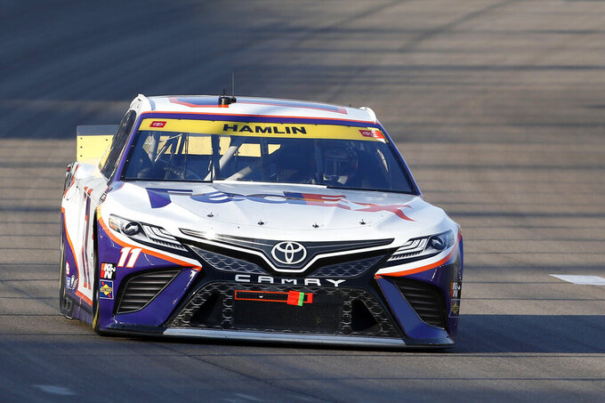 NASCAR Cup Series driver Denny Hamlin (11) races through Turn 1 during a NASCAR Cup Series auto race at the Las Vegas Motor Speedway, Sunday, Sept. 26, 2021, in Las Vegas. Hamlin went on to win the race. (AP Photo/Steve Marcus)