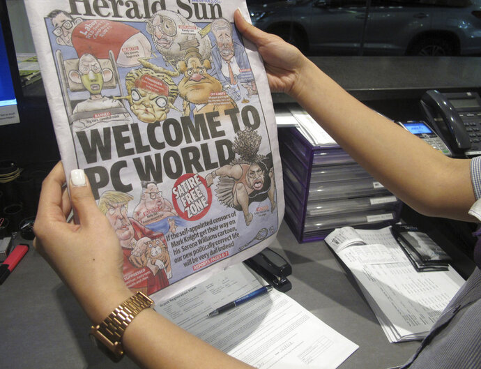 Melbourne-based newspaper Herald Sun displays a controversial cartoon of Serena Williams that has been widely condemned as a racist depiction of the tennis great, in Melbourne, Australia, Wednesday, Sept. 12, 2018. The newspaper defended its cartoonist Mark Knight's depiction of Williams and is asserting the condemnation, which has come from all parts of the world, is driven by political correctness. (AP Photo)
