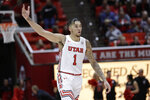 Utah forward Timmy Allen (1) celebrates as he walks up the court during the second half of an NCAA college basketball game against UC Davis Friday, Nov. 29, 2019, in Salt Lake City. (AP Photo/Rick Bowmer)