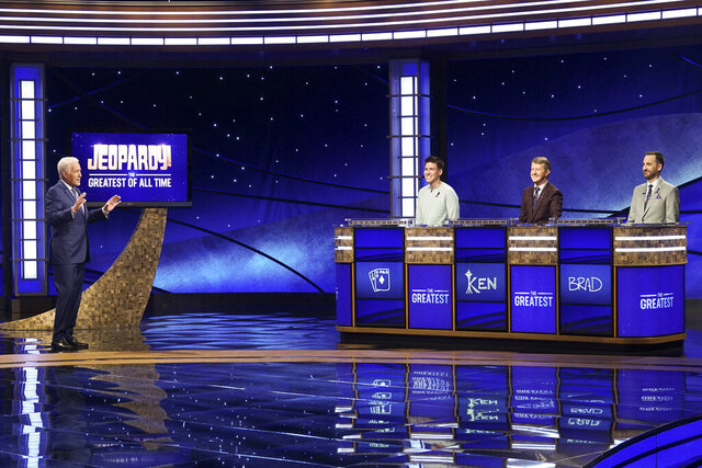 In this image released by ABC, host Alex Trebec, left, appear with contestants, James Holzhauer, center, Ken Jennings and Brad Rutter, right, on the set of
