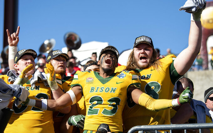 North Dakota State's Jaylaan Wimbush (23) celebrates with Aaron Steidl, left, and Zack Johnson, right, after defeating Eastern Washington in the FCS Football Championship NCAA college football game, Saturday, Jan. 5, 2019, in Frisco, Texas. (AP Photo/Jeffrey McWhorter)