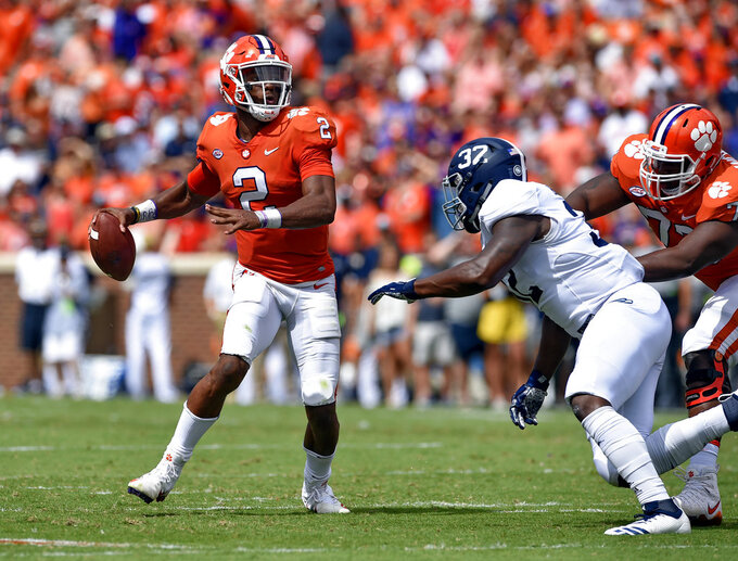 FILE - In this Saturday, Sept. 15, 2018, file photo, Clemson quarterback Kelly Bryant looks to pass while pressured by Georgia Southern's Lane Ecton during the first half of an NCAA college football game in Clemson, S.C. The Tigers  remain committed to playing both incumbent starter Kelly Bryant and highly rated freshman Trevor Lawrence as they head into Saturday's Atlantic Coast Conference opener against struggling Georgia Tech. (AP Photo/Richard Shiro, FIle)