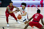 Illinois guard Andre Curbelo (5) drives between Rutgers guards Jacob Young (42) and Montez Mathis (10) during the second half of an NCAA college basketball game at the Big Ten Conference men's tournament in Indianapolis, Friday, March 12, 2021. (AP Photo/Michael Conroy)