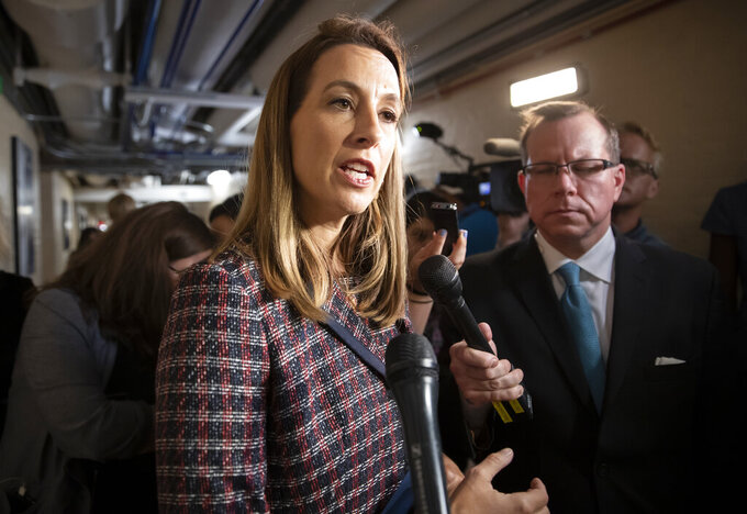 "FILE - In this Sept. 24, 2019, file photo Rep. Mikie Sherrill, D-N.J., talks to reporters at the Capitol in Washington. As President Donald Trump tries to moves on from the coronavirus, Congress is rushing to fill the void and prepare the country for the long fight ahead. ""This is going to be on us,"" said Sherrill, D-N.J. (AP Photo/J. Scott Applewhite, File)"