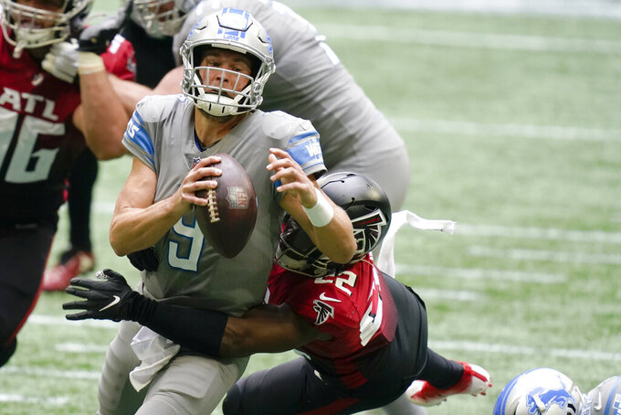 Detroit Lions quarterback Matthew Stafford (9) is sacked by Atlanta Falcons strong safety Keanu Neal (22) during the second half of an NFL football game, Sunday, Oct. 25, 2020, in Atlanta. (AP Photo/Brynn Anderson)