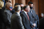 Assemblyman Minority Leader William A. Barclay, R- Fulton, second from right, stands with Assembly Republicans calling for the impeachment of New York Gov. Andrew Cuomo during a news conference at the state Capitol, Monday, March 8, 2021, in Albany, N.Y. (AP Photo/Hans Pennink)