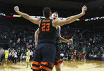 Oregon State's Gligorije Rakocevic, left, and Kylor Kelley celebrate their win over Oregon in an NCAA college basketball game Saturday, Jan. 5, 2019, in Eugene, Ore. (AP photo/Chris Pietsch)