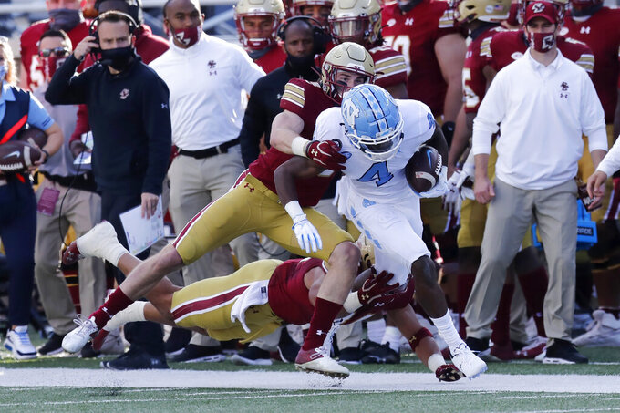 Boston College defensive back Mike Palmer, center left, stops North Carolina wide receiver Rontavius Groves (4) during the first half of an NCAA college football game, Saturday, Oct. 3, 2020, in Boston. (AP Photo/Michael Dwyer)