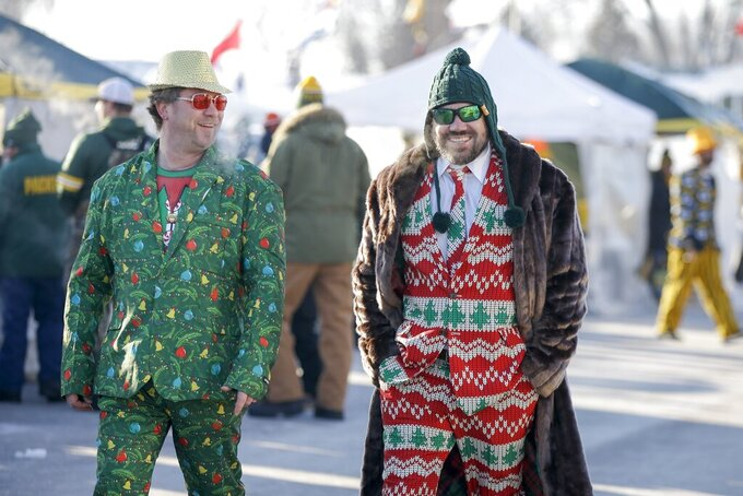 Fans make their way to Lambeau Field before an NFL football game between the Green Bay Packers and the Chicago Bears Sunday, Dec. 15, 2019, in Green Bay, Wis. (AP Photo/Mike Roemer)